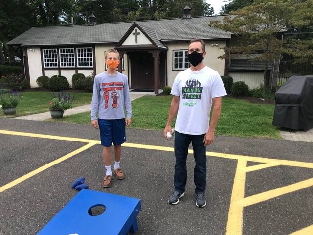Two boys outside with face masks